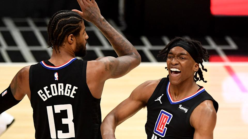 Reggie Jackson, right, reacts with teammate Paul George #13 of the LA Clippers after scoring and drawing the foul against the Utah Jazz. (Photo by Keith Birmingham/MediaNews Group/Pasadena Star-News via Getty Images)