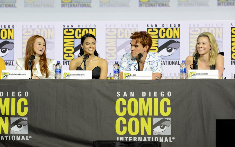 """SAN DIEGO, CALIFORNIA - JULY 21: (L-R) Madelaine Petsch, Camila Mendes, KJ Apa and Lili Reinhart speak at the """"Riverdale"""" Special Video Presentation and Q&A during 2019 Comic-Con International at San Diego Convention Center on July 21, 2019 in San Diego, California. (Photo by Albert L. Ortega/Getty Images)"""