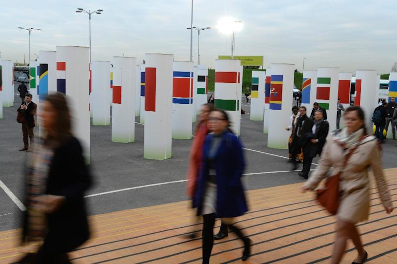 People arrive on December 2, 2015 at the World Climate Change Conference (COP21), in Le Bourget on the outskirts of Paris