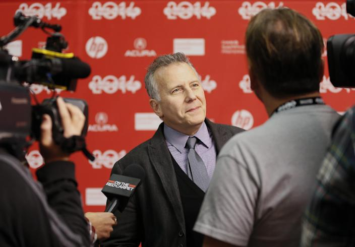 "Cast member Paul Reiser is interviewed at the opening night premiere of the film ""Whiplash"" during the 2014 Sundance Film Festival, on Thursday, Jan. 16, 2014, in Park City, Utah. (Photo by Danny Moloshok/Invision/AP)"