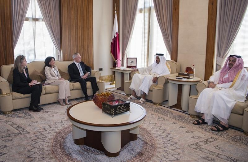 In this April 22, 2017 photo released by the U.S. Defence Department, Secretary of Defense Jim Mattis, centre left, meets with Qatar's Emir Sheikh Tamim bin Hamad Al Thani as Sally Donnelly, Mattis' advisor, 2nd left, and Dana Smith, U.S. ambassador to Qatar, 1st left, and Qatar's Minister of Defence Khalid bin Mohammed al Attiyah are seen at the Sea Palace in Doha, Qatar. A trip by Qatar's ruling emir to a major U.S. military base in his country, on Monday, Sept. 11, 2017, has shown the delicate balancing act the U.S. faces in addressing the diplomatic crisis gripping Doha. (US Defence Department/ Brigitte N. Brantley via AP)