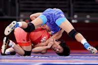 <p>Takuto Otoguro of Team Japan competes against Tulga Tumur Ochir of Team Mongolia during the Men's Freestyle 65kg 1/8 Final on day fourteen of the Tokyo 2020 Olympic Games at Makuhari Messe Hall on August 06, 2021 in Chiba, Japan. (Photo by Ezra Shaw/Getty Images)</p>