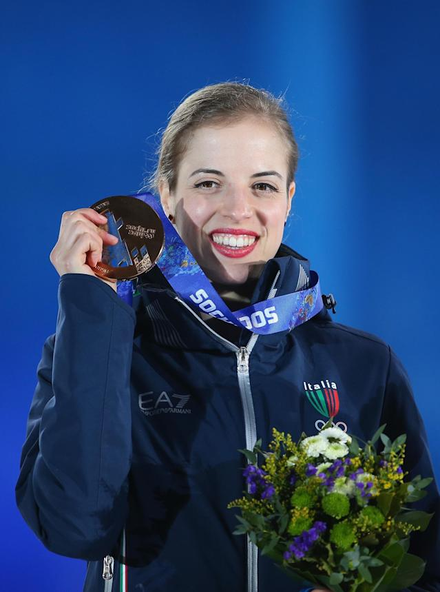SOCHI, RUSSIA - FEBRUARY 21: Bronze medalist Carolina Kostner of Italy celebrates during the medal ceremony for the Women's Free Figure Skating on day fourteen of the Sochi 2014 Winter Olympics at Medals Plaza on February 21, 2014 in Sochi, Russia. (Photo by Quinn Rooney/Getty Images)