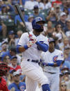 Chicago Cubs' Jason Heyward watches after hitting a two-run double during the seventh inning of a baseball game against the Cincinnati Reds in Chicago, Wednesday, July 17, 2019. (AP Photo/Nam Y. Huh)