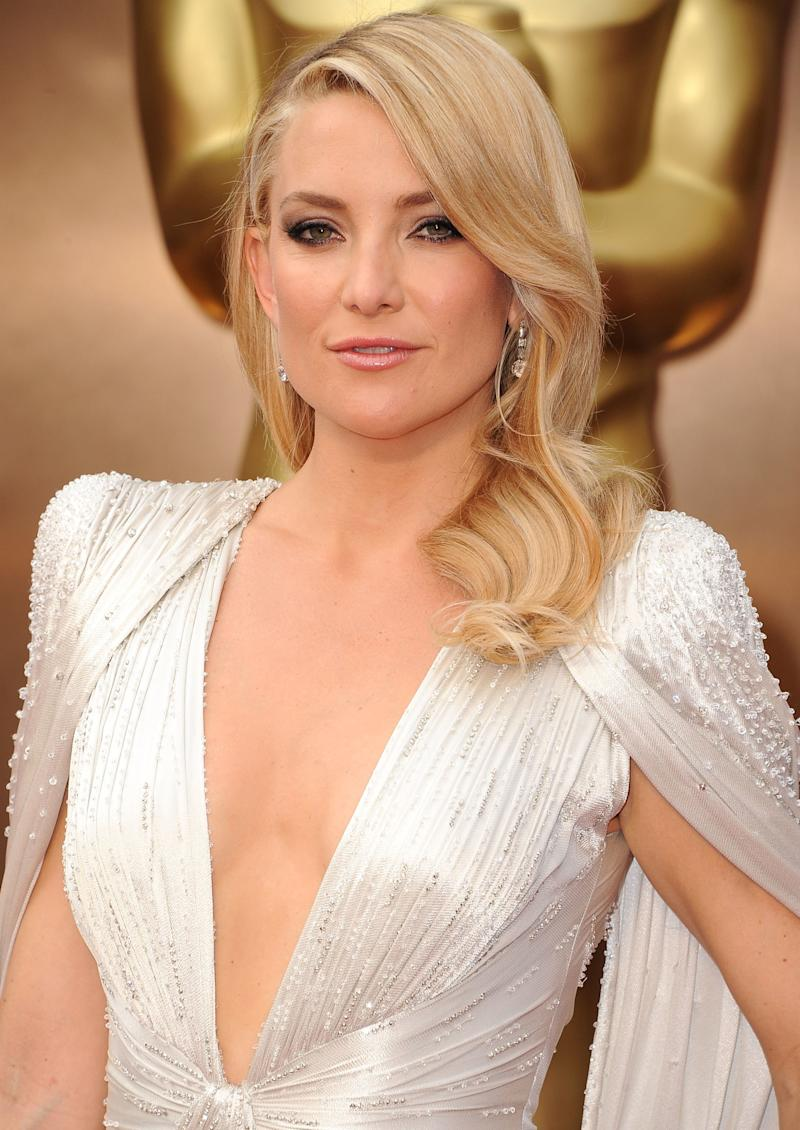Looking regal at 86th Annual Academy Awards in 2014, Hudson wears her elegant waves with a subtle smokey eye.