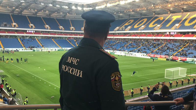 FILE - In this file photo released by Russian Emergency Situations Ministry on April 28, 2018, a Russian Emergencies Ministry officer attends a training session to ensure security at the World Cup during drills at the World Cup stadium in Rostov-on-Don, Russia. A year after hosting the World Cup, Russia is boasting the biggest club soccer crowds since Soviet days and participation at the amateur level is on the rise. Still, there are signs of trouble for the sport. (Russian Ministry for Emergency Situations photo via AP, File)