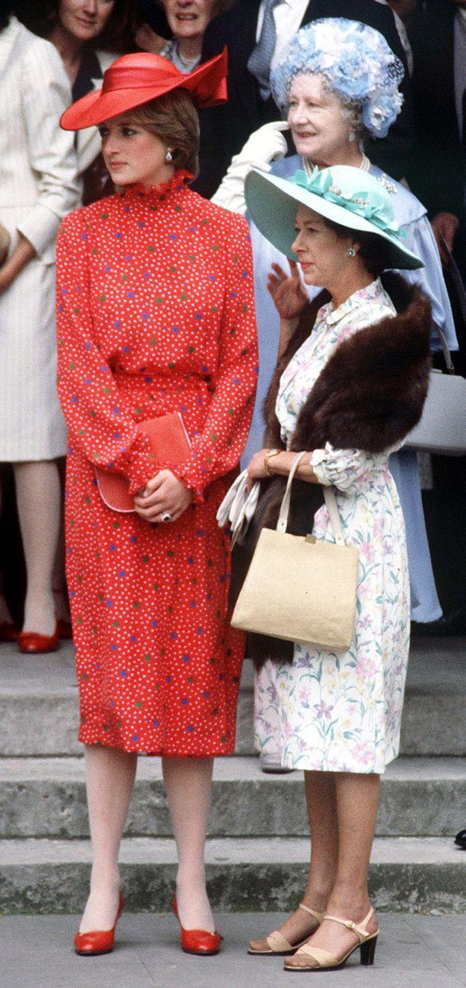 <p>In a red polka dot dress and matching hat while attending Nicholas Soames's wedding in Westminster, London with Queen Elizabeth. </p>