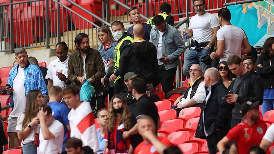 Stadium security, pictured here checking tickets as fans take their seats inside Wembley Stadium.