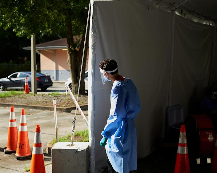 Health care workers while conducting nasal swab coronavirus tests at a drive-in testing facility at the Wimauma Opportunity Center in Wimauma, Fla., south of Tampa, on July 9, 2020. (Zack Wittman/The New York Times)