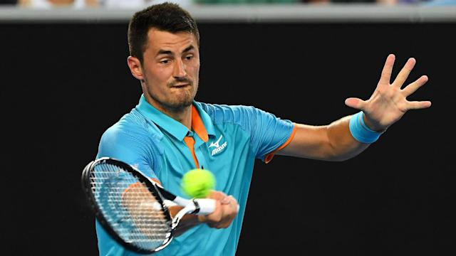There were contrasting fortunes for Bernard Tomic and Tennys Sandgren at the New York Open.