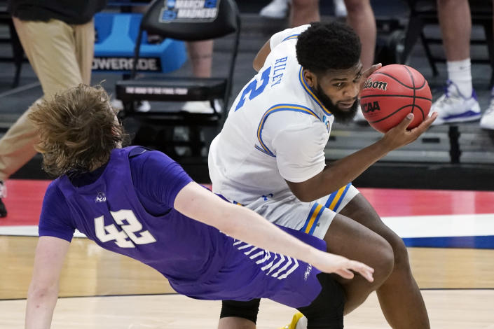 UCLA's Cody Riley (2) collides with Abilene Christian's Clay Gayman (42) during the first half of a college basketball game in the second round of the NCAA tournament at Bankers Life Fieldhouse in Indianapolis Monday, March 22, 2021. (AP Photo/Mark Humphrey)
