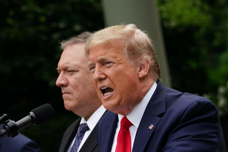 US President Donald Trump, with US Secretary of State Mike Pompeo, holds a press conference on China on May 29, 2020, in the Rose Garden of the White House in Washington, DC. - Trump held the press conference amid soaring tensions between the two powers, including over the status of Hong Kong and the novel coronavirus pandemic. (Photo by MANDEL NGAN / AFP) (Photo by MANDEL NGAN/AFP via Getty Images)