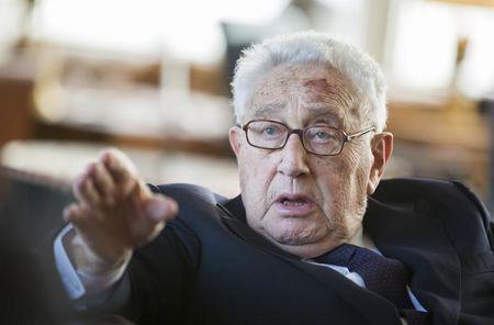 Former U.S. Secretary of State Kissinger gestures during a reception for his 90th birthday in Berlin