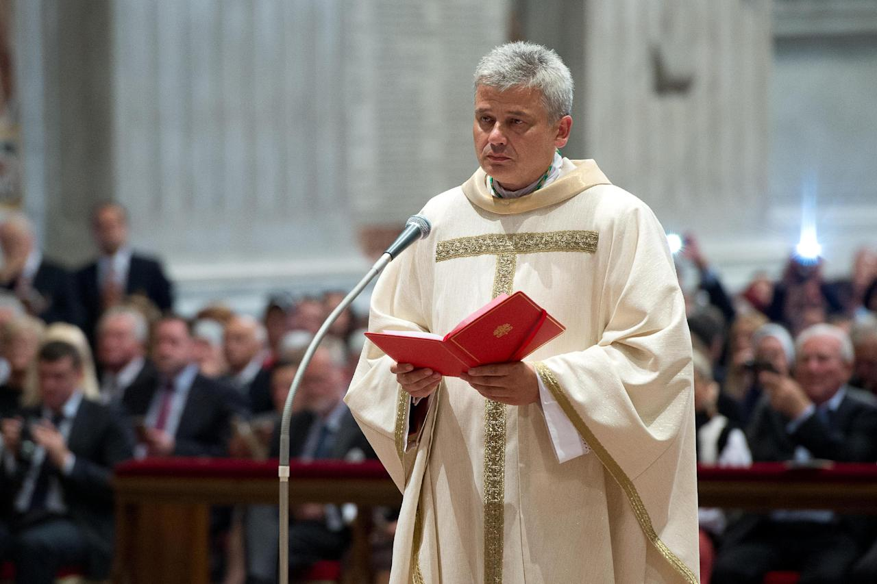 In this photo taken on Sept.19, 2013 provided by the Vatican newspaper L'Osservatore Romano, Vatican Almoner, Archbishop Konrad Krajewski attends the ceremony for his episcopal ordination, in St. Peter's Basilica, at the Vatican. The existence of the Vatican Almoner dates back centuries: It is mentioned in a papal bull from the 13th-century Pope Innocent III, and Pope Gregory X, who ruled from 1271-1276, organized it into an official Holy See office for papal charity. Up until Krajewski came along, the almoner was typically an aging Vatican diplomat who was serving his final years before being allowed to retire at age 75. Francis changed all that, tapping the 50-year-old Pole to be a more vigorous, hands-on extension of himself. The almoner's duties are two-fold: carrying out acts of charity, and raising the money to fund them. (AP Photo/L'Osservatore Romano, ho)