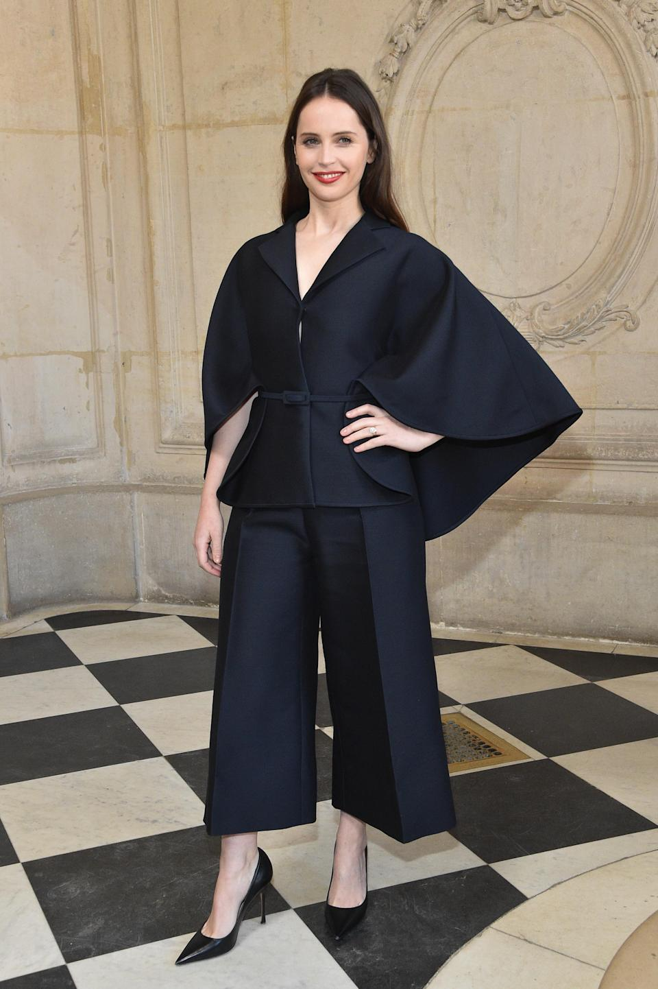 <p>On January 21, actress Felicity Jones gave us a lesson in chic tailoring courtesy of a super-sleeved blazer and wide-leg trousers. A lick of red lipstick and minimal courts finished the FROW ensemble. <em>[Photo: Getty]</em> </p>