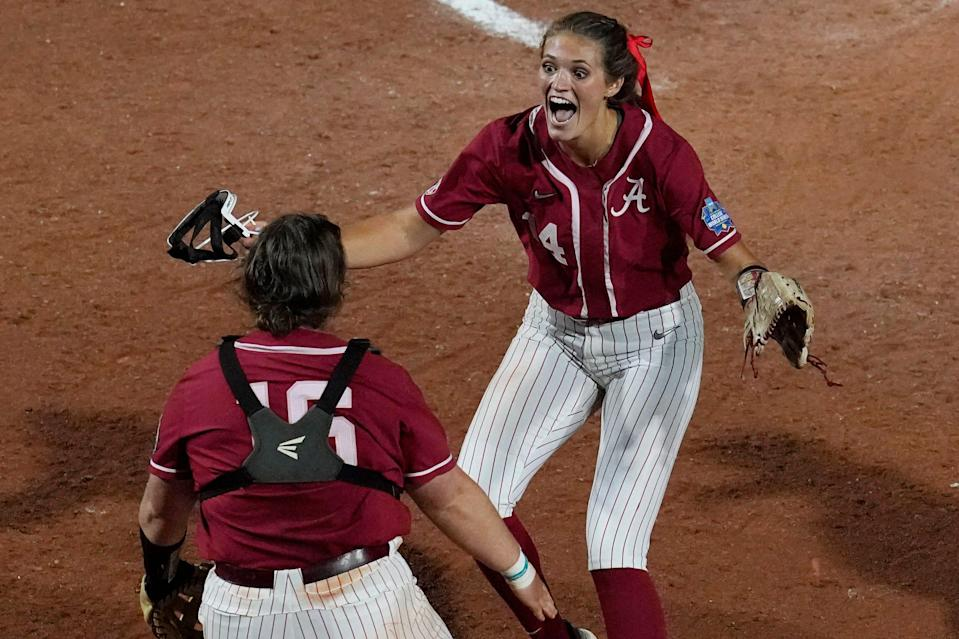 Alabama pitcher Montana Fouts, right, celebrates her perfect game against UCLA with Bailey Hemphill.