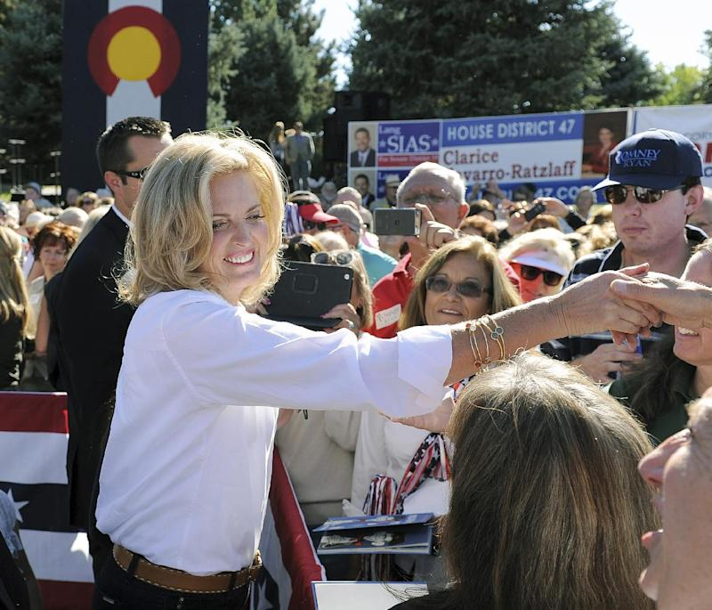 "FILE - This Oct. 2, 2012 file photo shows Ann Romney, wife of Republican presidential candidate Mitt Romney, shakes hands with supporters at a campaign event at Hudson Gardens and Event Center in Littleton, Colo. Republican presidential candidate Mitt Romney's wife says her husband will not run again if this race doesn't turn out the way they hope. Ann Romney told ABC's ""The View"" Thursday that it was ""a very hard thing"" to put her family through another White House bid after he lost the 2008 Republican primary. She said she agreed because she feels her husband can bring economic prosperity to America, but they ""absolutely"" will not do it again if he loses.  (AP Photo/Chris Schneider, File)"