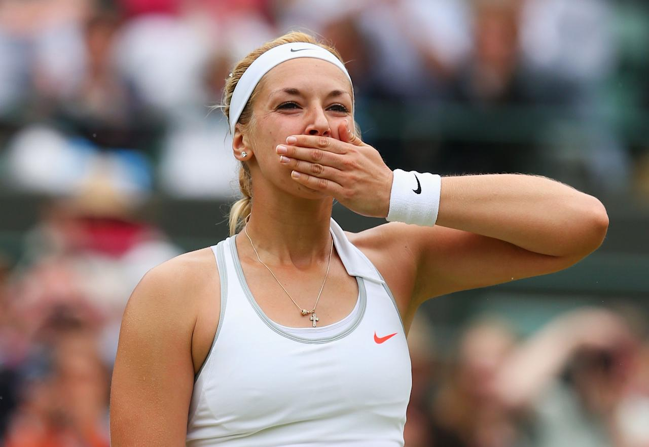 LONDON, ENGLAND - JULY 02: Sabine Lisicki of Germany celebrates victory during the Ladies' Singles quarter-final match against Kaia Kanepi of Estonia on day eight of the Wimbledon Lawn Tennis Championships at the All England Lawn Tennis and Croquet Club at Wimbledon on July 2, 2013 in London, England. (Photo by Julian Finney/Getty Images)
