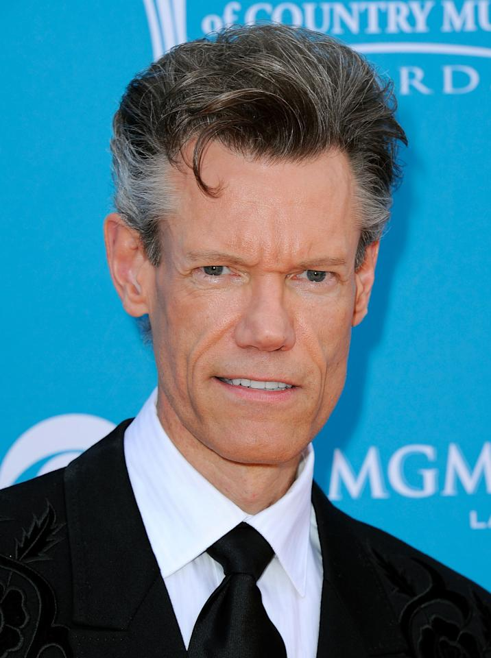 LAS VEGAS - FILE:  Musician Randy Travis arrives for the 45th Annual Academy of Country Music Awards at the MGM Grand Garden Arena on April 18, 2010 in Las Vegas, Nevada.  Country musician Randy Travis was arrested for public intoxication February 6, 2012 in Sanger, Texas.  Travis was given a citation and later released.  (Photo by Kevork Djansezian/Getty Images)