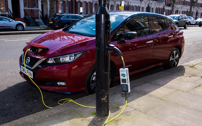 electric Nissan Leaf being charged on Sutherland Avenue, London - Anthony Upton/PA