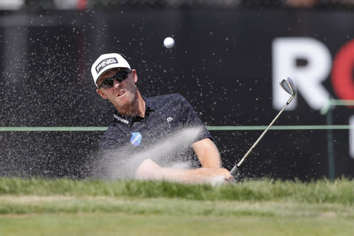 Seamus Power hits onto the 11th green during the third round of the Rocket Mortgage Classic golf tournament Saturday, July 4, 2020, at Detroit Golf Club in Detroit. (AP Photo/Carlos Osorio)