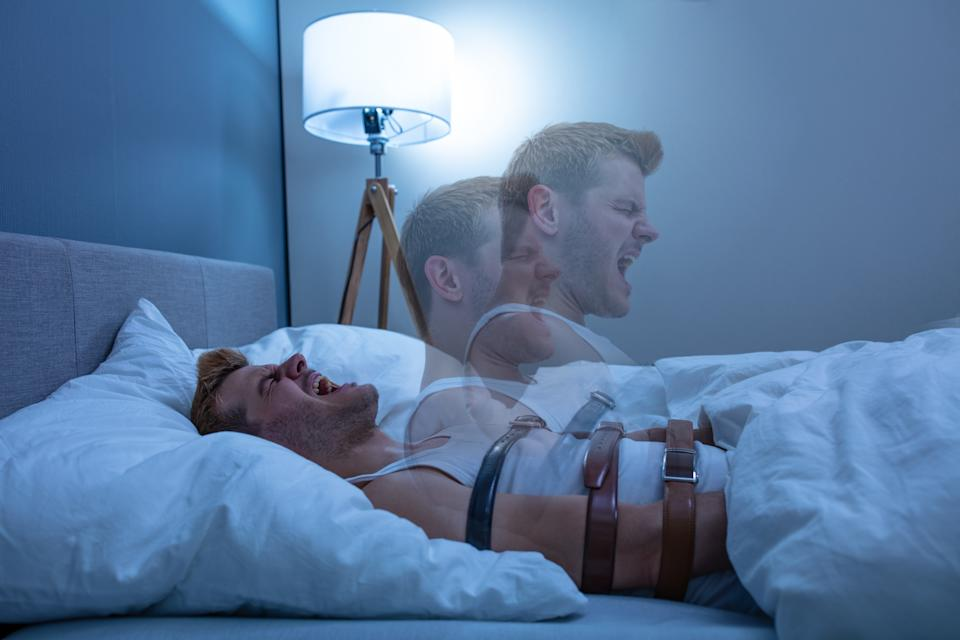 Man Suffering From Sleep Paralysis At Home