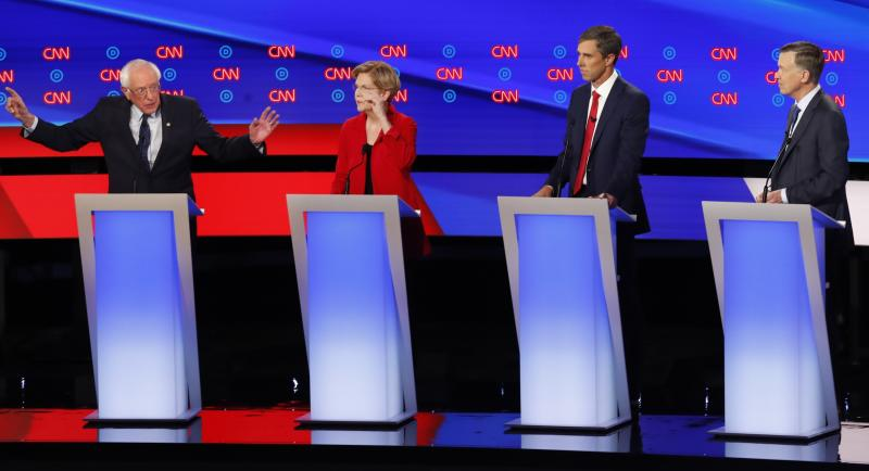 Sen. Bernie Sanders, I-Vt., Sen. Elizabeth Warren, D-Mass., former Texas Rep. Beto O'Rourke and former Colorado Gov. John Hickenlooper participate in the first of two Democratic presidential primary debates hosted by CNN Tuesday, July 30, 2019, in the Fox Theatre in Detroit. (AP Photo/Paul Sancya)