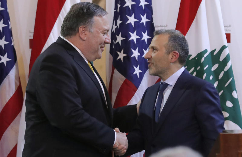 U.S. Secretary of State Mike Pompeo shakes hands with Lebanese Foreign Minister Gebran Bassil after a public statement in Beirut, Lebanon, Friday, March 22, 2019. (Jim Young/Pool Image via AP)