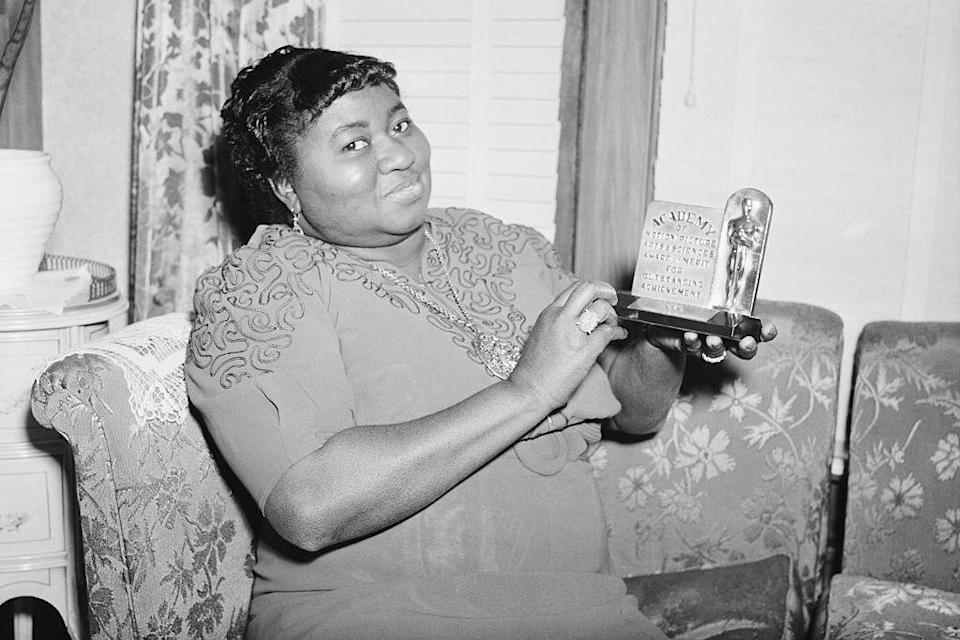 """<p>At the 1940 Academy Awards, <a rel=""""nofollow noopener"""" href=""""https://en.wikipedia.org/wiki/Hattie_McDaniel"""" target=""""_blank"""" data-ylk=""""slk:McDaniel"""" class=""""link rapid-noclick-resp"""">McDaniel</a> broke down barriers when she became the first African American to ever win an Oscar. Even with the statue for Best Supporting Actress in her hands, though, McDaniel and her escort (exceptions to the Los Angeles Ambassador Hotel's """"no-blacks policy"""") were reportedly forced to sit at a separate table it the back.</p>"""