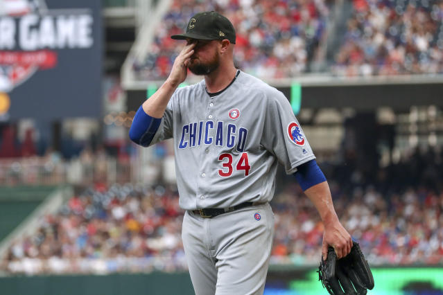Chicago Cubs starting pitcher Jon Lester wipes his face as he walks off the field at the end of the second inning of the team's baseball game against the Washington Nationals, Saturday, May 18, 2019, in Washington. (AP Photo/Andrew Harnik)