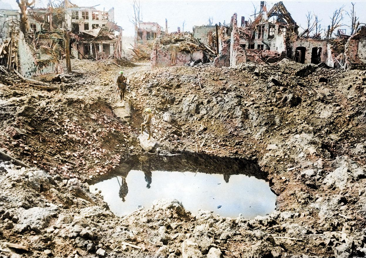 <p>Ypres, Belgium in October 1917 after it had been destroyed by bombing, leaving a large crater behind (Royston Leonard / Media Drum World / Caters News) </p>