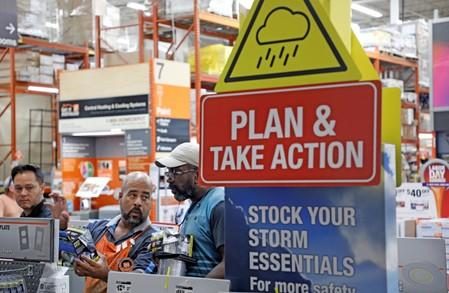Home Depot worker helps a customer get supplies ahead of the arrival of Hurricane Dorian in Kissimmee