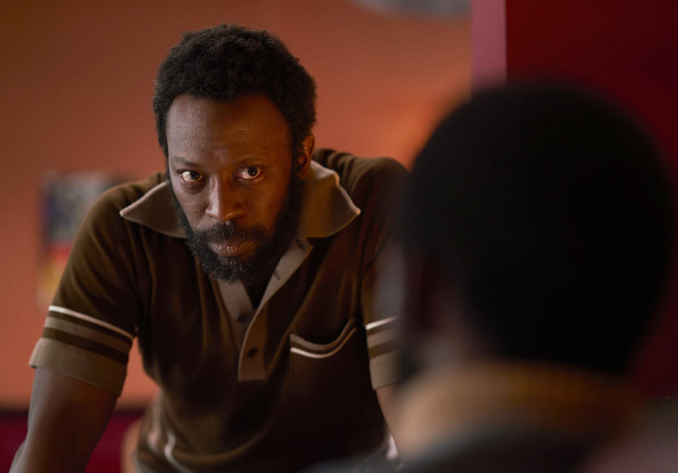 """This image released by Amazon Prime Video shows Shaun Parkes as Frank Crichlow in a scene from """"Mangrove."""" (Des Willie/Amazon Prime Video via AP)"""