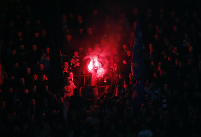 Frankfurt supporters light a flare during the Europa League round of 16 second leg soccer match between Inter Milan and Eintracht Frankfurt at the San Siro stadium in Milan, Italy, Thursday, March 14, 2019. (AP Photo/Antonio Calanni)