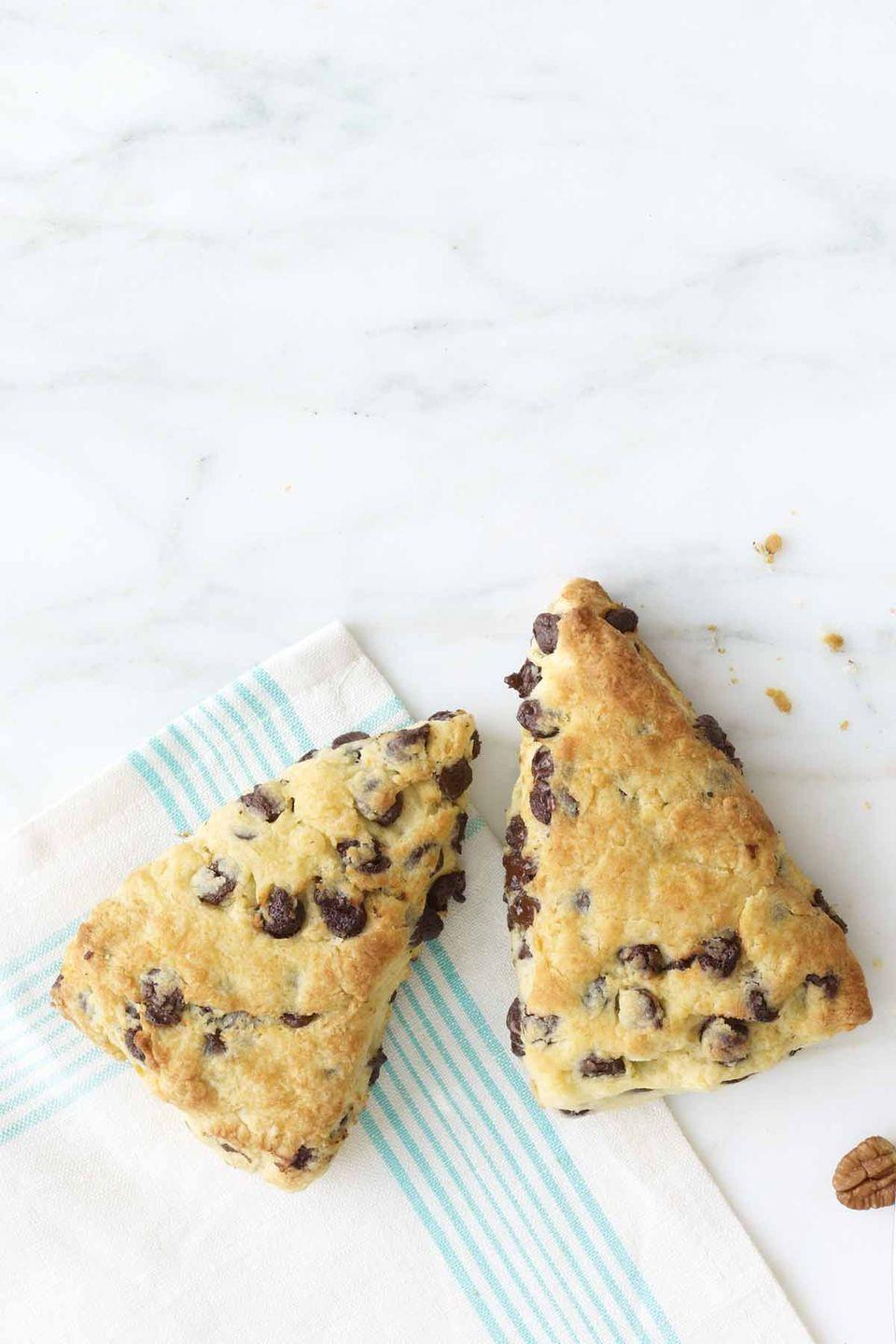 """<p>Wake mom up with a sweet treat that features every's favorite ingredient: chocolate! </p><p><strong><a href=""""https://www.womansday.com/food-recipes/food-drinks/recipes/a12057/sour-cream-chocolate-chip-scones-recipe-wdy0413/"""" rel=""""nofollow noopener"""" target=""""_blank"""" data-ylk=""""slk:Get the Chocolate Chip Scones recipe."""" class=""""link rapid-noclick-resp""""><em>Get the Chocolate Chip Scones recipe. </em></a></strong> </p>"""