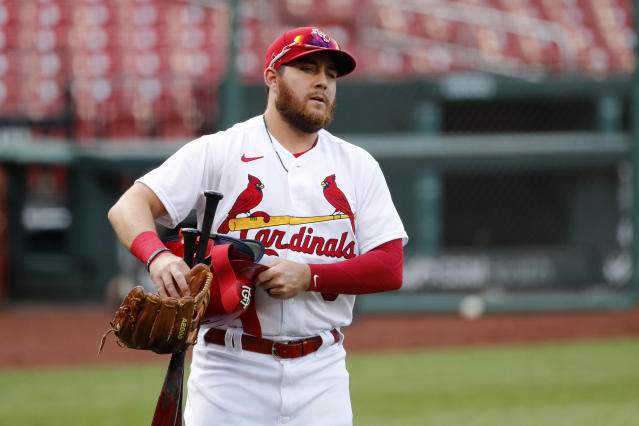 St. Louis Cardinals' Austin Dean carries his gear before an intrasquad practice baseball game at Busch Stadium Thursday, July 9, 2020, in St. Louis. (AP Photo/Jeff Roberson)