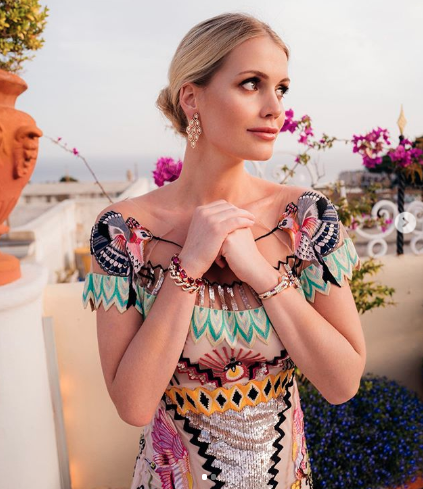 Lady Kitty Spencer poses on the mediterranean in a colourful dress