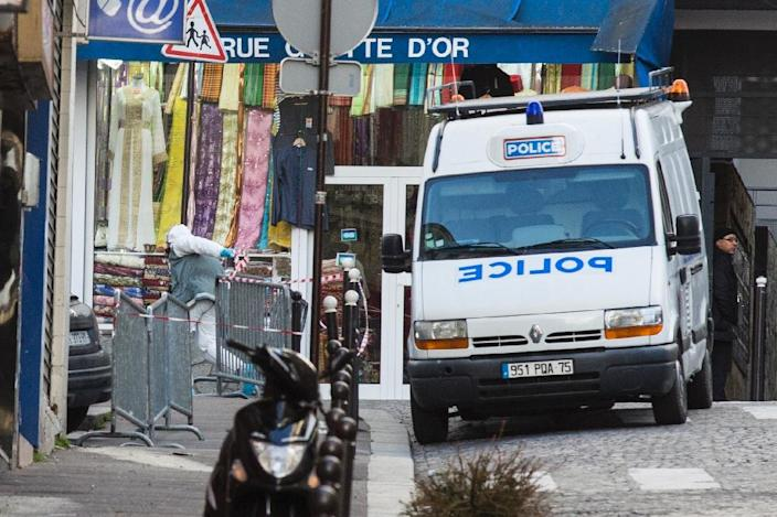 An expert of the technical and scientific police unit (L) is pictured in the Rue de la Goutte d'Or in northern Paris on January 7, 2016, after police shot dead a man who attempted to attack a police station (AFP Photo/Florian David)