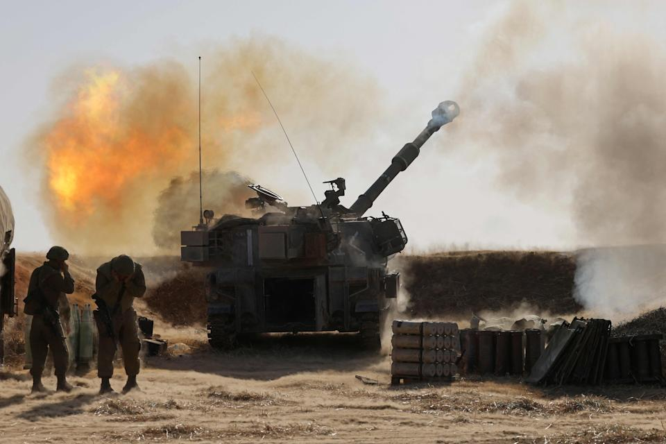 Israeli soldiers fire a howitzer towards targets in the Gaza StripAFP via Getty Images