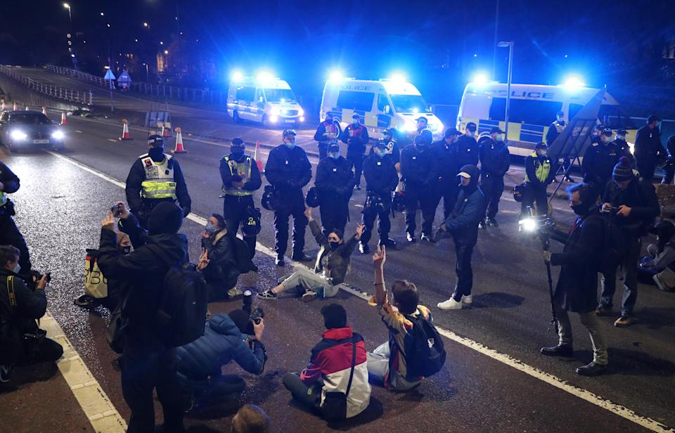 Police face demonstrators on the A4032 which leads to the M32 in Bristol during a 'Kill The Bill' protest against The Police, Crime, Sentencing and Courts Bill. Picture date: Saturday April 3, 2021.