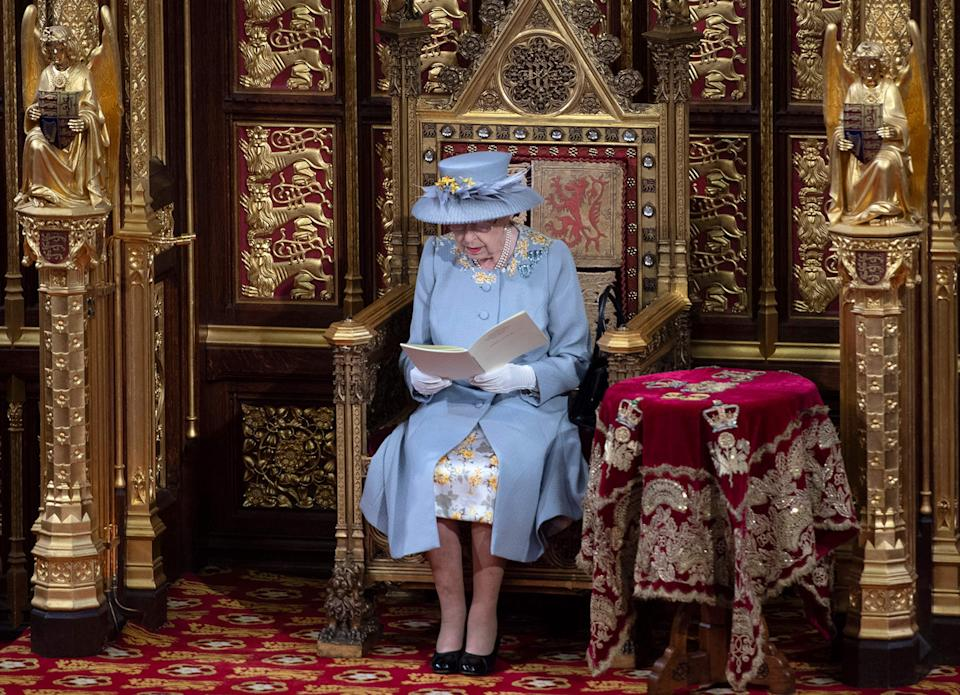 Queen Elizabeth II reads the Queen's Speech on the The Sovereign's Throne in the House of Lords during the State Opening of Parliament in London on May 11, 2021.