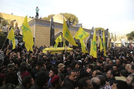 Lebanon's Hezbollah members and supporters carry the coffin of Jihad Moughniyah during his funeral in Beirut's suburbs