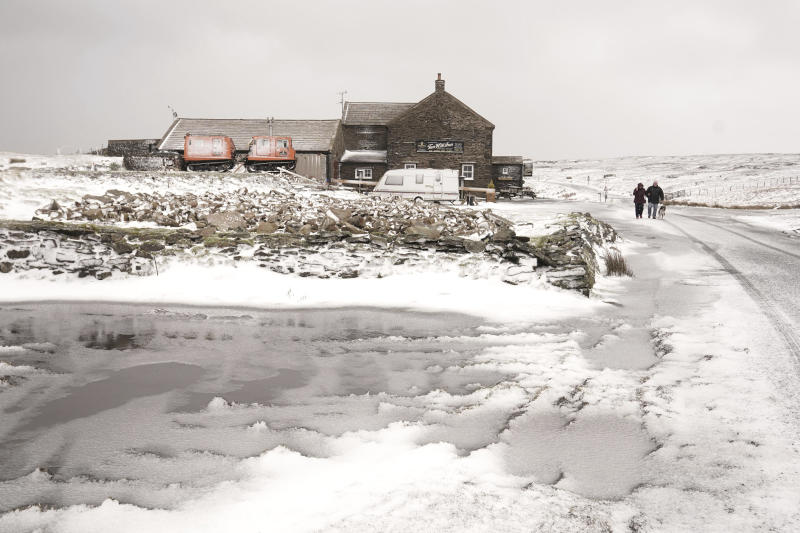 A general view of snowy conditions at the Tan Hill Inn in Reeth in the Yorkshire Dales, England, Monday, Feb. 10, 2020. Storm Ciara battered the U.K. and northern Europe with hurricane-force winds and heavy rains Sunday, halting flights and trains and producing heaving seas that closed down ports. Propelled by the fierce winds, a British Airways plane was thought to have made the fastest New York-to-London flight by a conventional airliner. (Owen Humphreys/PA via AP)