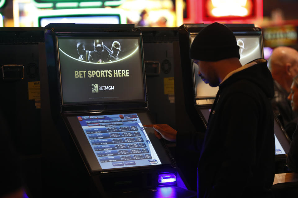 A gambler enters his bet during the launch of legalized sports betting in Michigan at the MGM Grand Detroit casino in Detroit, Wednesday, March 11, 2020. (AP Photo/Paul Sancya)