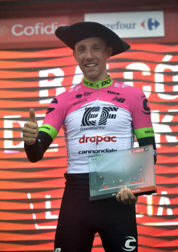 Canada's Michael Woods celebrates on the podium after winning the 17th stage of the Spanish Vuelta cycling race between Getxo and Balcon de Vizcaya, northern Spain, Wednesday, Sept.12, 2018. (AP Photo/Alvaro Barrientos)