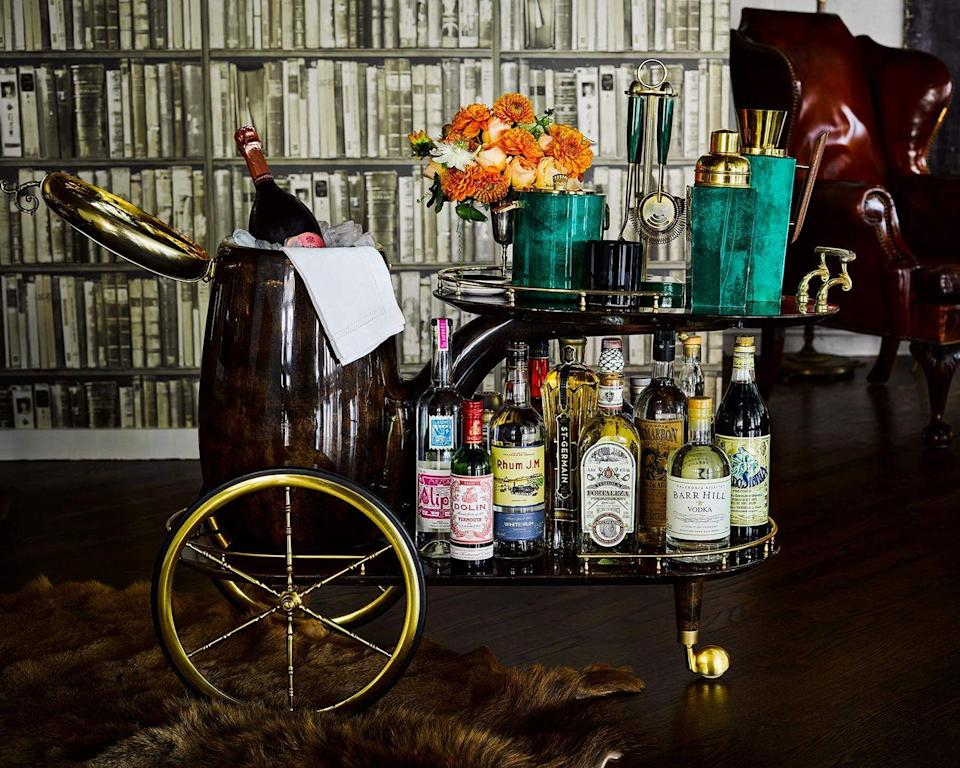 """<p>When styling your bar cart or table, San Francisco–based designer <a href=""""http://kenfulk.com"""" rel=""""nofollow noopener"""" target=""""_blank"""" data-ylk=""""slk:Ken Fulk"""" class=""""link rapid-noclick-resp"""">Ken Fulk</a> puts the emphasis on the creating a mood and look - no matter whether cocktail hour is just for yourself or you are entertaining guests.</p><p> """"I prefer to treat a bar cart as a tableau rather than simply a dispenser of drinks,"""" says Fulk. """"I often include flowers, favorite objects, or a framed photo. This cart has this fantastic built-in ice bucket. Otherwise, I often utilize an interesting cachepot (with a plastic liner) for a collected look."""" </p><p>This already-handsome wheeled bar cart gets an upgrade with malachite accessories and fresh flowers. </p><p><a class=""""link rapid-noclick-resp"""" href=""""https://go.redirectingat.com?id=74968X1596630&url=https%3A%2F%2Fwww.etsy.com%2Flisting%2F777165962%2F1960s-faux-malachite-culver-ice-bucket%3Fga_order%3Dmost_relevant%26ga_search_type%3Dall%26ga_view_type%3Dgallery%26ga_search_query%3Dmalachite%2Bbarware%26ref%3Dsr_gallery-1-42&sref=https%3A%2F%2Fwww.veranda.com%2Fhome-decorators%2Fg32370259%2Fbar-cart-ideas%2F"""" rel=""""nofollow noopener"""" target=""""_blank"""" data-ylk=""""slk:Get The Look"""">Get The Look</a></p>"""