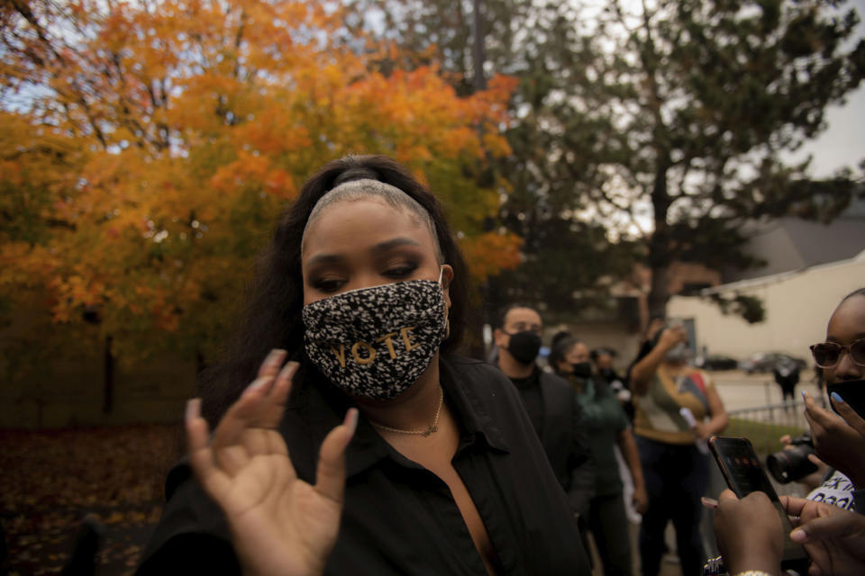 Lizzo reaches for a pen to sign autographs during a campaigns in Detroit for Democratic Presidential Candidate Joe Biden and Kamala Harris on Friday Oct. 23, 2020 in Detroit. (Nicole Hester/Ann Arbor News via AP)