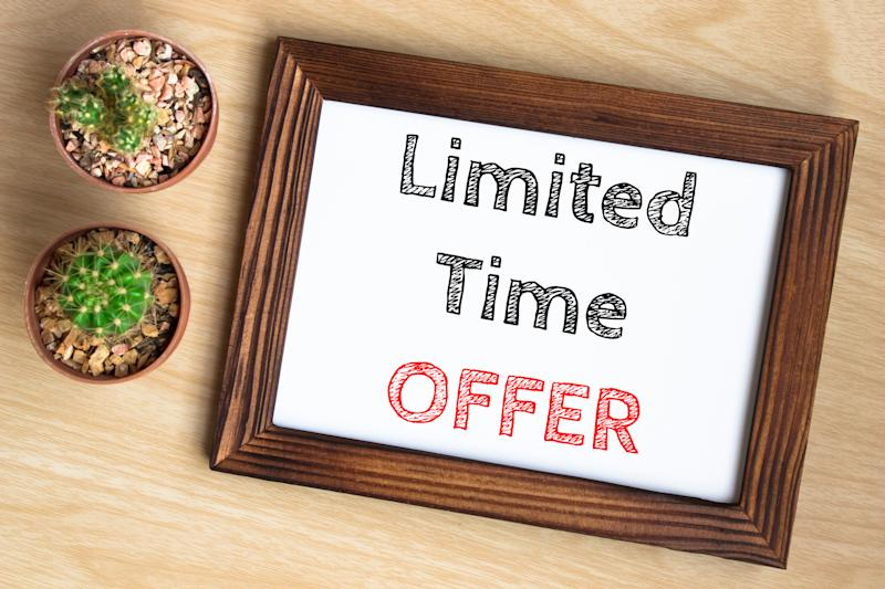 Limited time offer written on a wooden frame board.