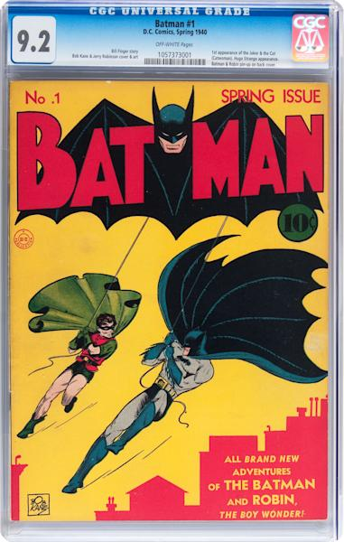 "This image provided by Heritage Auctions on July 2, 2013 shows a 9.2-graded copy of ""Batman"" No. 1 from 1940, depicting Batman and Robin swinging in front of a Gotham city skyline. It is planned to go on auction in August 2013. A similar copy sold for $850,000 in 2012. (AP Photo/Heritage Auctions)"