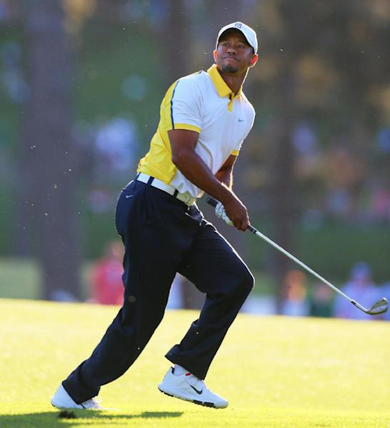 Golfer Tiger Woods reacts to his recovery shot from off the fairway over the trees to the 17th green during the second round in the Masters golf tournament on Friday, April 12, 2013, in Augusta, Ga. (AP Photo/Atlanta Journal-Constitution, Curtis Compton) MARIETTA DAILY OUT; GWINNETT DAILY POST OUT; LOCAL TV OUT; WXIA-TV OUT; WGCL-TV OUT.